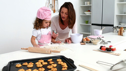 Wonderfull mother baking with her daughter Footage