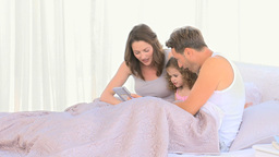 Nice family together in bed Stock Video Footage