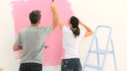Nice couple painting the wall together Footage