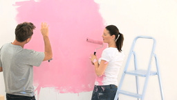 Nice couple painting the wall together Stock Video Footage