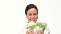 A businesswoman counting her money Stock Video Footage
