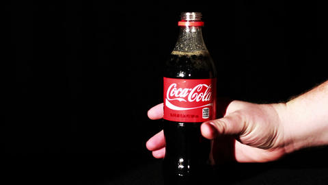 Coca-Cola Bottle Being Picked Up Footage