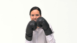 Smiling businesswoman boxing towards the camera Footage
