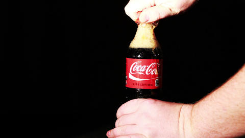 Coca-Cola Bottle Being Open Up Stock Video Footage