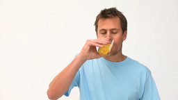Cute man drinking his glass of orange juice Stock Video Footage