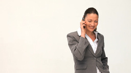 Smilling and pretty businesswoman phoning Stock Video Footage