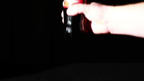 Coca-Cola Bottle Being Picked Up The Slammed Footage