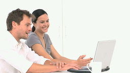 Lovely smiling couple searching something on their Stock Video Footage