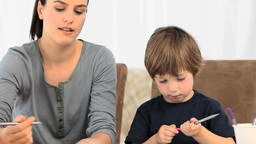 Mother Drawing With Her Son stock footage