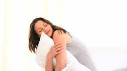 Happy woman hugging a pillow Stock Video Footage
