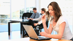 Businesswoman working on her laptop in an office Stock Video Footage