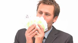 Businessman smelling euro notes Footage