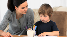 Boy Drawing With His Mother stock footage