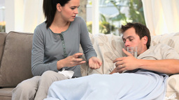 Worried woman giving pills to her sick husband Stock Video Footage