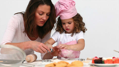 Mother baking cookies with her daughter Stock Video Footage