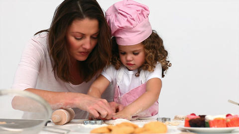 Mother baking cookies with her daughter Footage