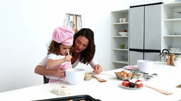 Little girl preparing dough with her mother Stock Video Footage
