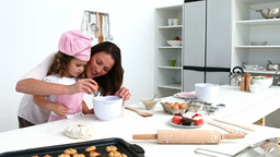 Mother and daughter preparing the dough for baking Stock Video Footage