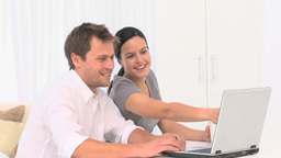 Couple chatting on internet with a laptop Stock Video Footage