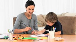 Boy and mom drawing together Stock Video Footage