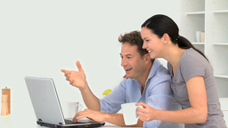 Couple looking at a video on the laptop Stock Video Footage