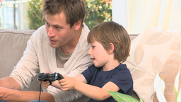 Father and son playing video games Footage