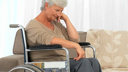 Elderly Woman In A Wheelchair Thinking stock footage