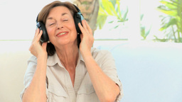 Senior woman listening music Stock Video Footage