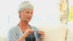 Senior woman knitting Stock Video Footage