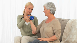 A nurse helping her patient to do an exercice Stock Video Footage