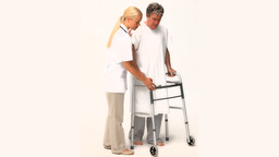 A nurse helping a patient to walk Footage