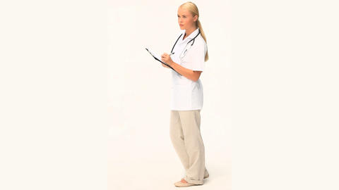 A blond nurse checking her patient Footage