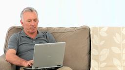 Elderly man working on a computer Footage