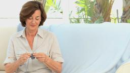 Elderly woman knitting Footage