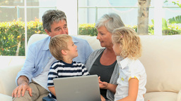 Family in front of a computer talking Stock Video Footage