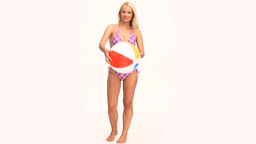 Woman in a swimsuit playing with a ball Stock Video Footage