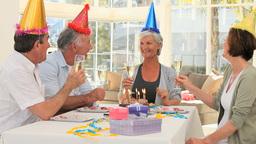 Elderly friends celebrating a birthday Footage