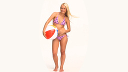 Woman in swimsuit playing with a ball Footage