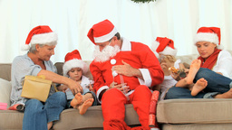 Santa Claus with an happy family Footage
