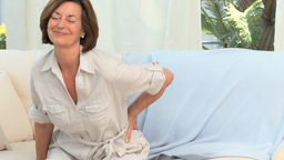Retired woman with a back pain Stock Video Footage