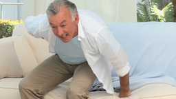 Retired man having a back pain Footage