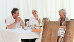 Family laughing during dinner Stock Video Footage
