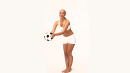Pretty blonde woman playing with a soccer ball Footage