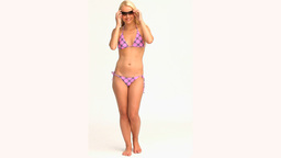 Blonde woman in swimsuit playing with sunglasses Stock Video Footage