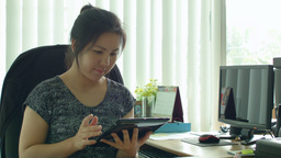 Young Asian Office Worker Working on Tablet Comput Footage