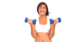 Brunette woman in sportswear with dumbbells Footage