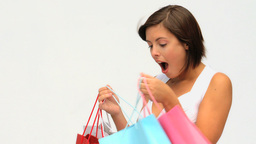 Brunette lady holding her shopping bags Stock Video Footage