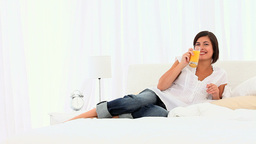 Cute woman drinking a glass of orange juice Stock Video Footage
