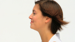 Cute brunette woman looking at the camera Stock Video Footage