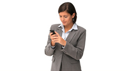 Cute businesswoman writing a text with her smartph Footage